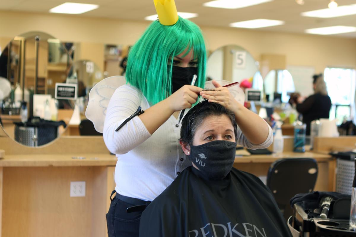 Deb Saucier gets a haircut at the VIU Salon